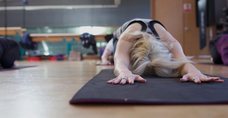 Yoga student in child's pose