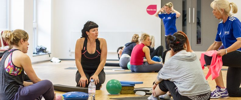 Two yoga instructors assessing a yoga qualification