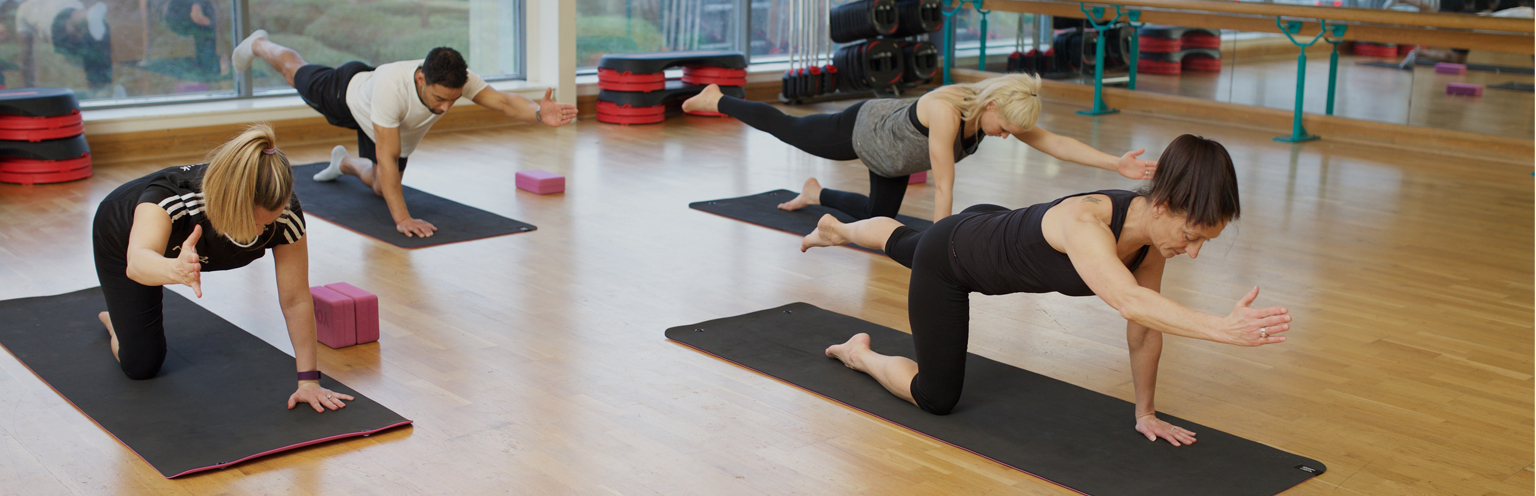 Pilates instructor leading a class in a studio