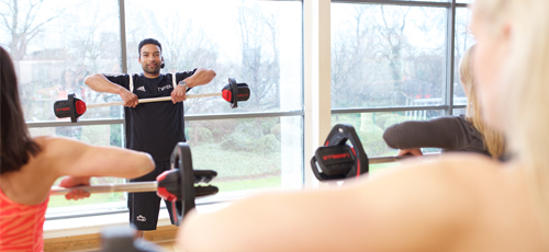 HFE instructor using a Les Mill barbell