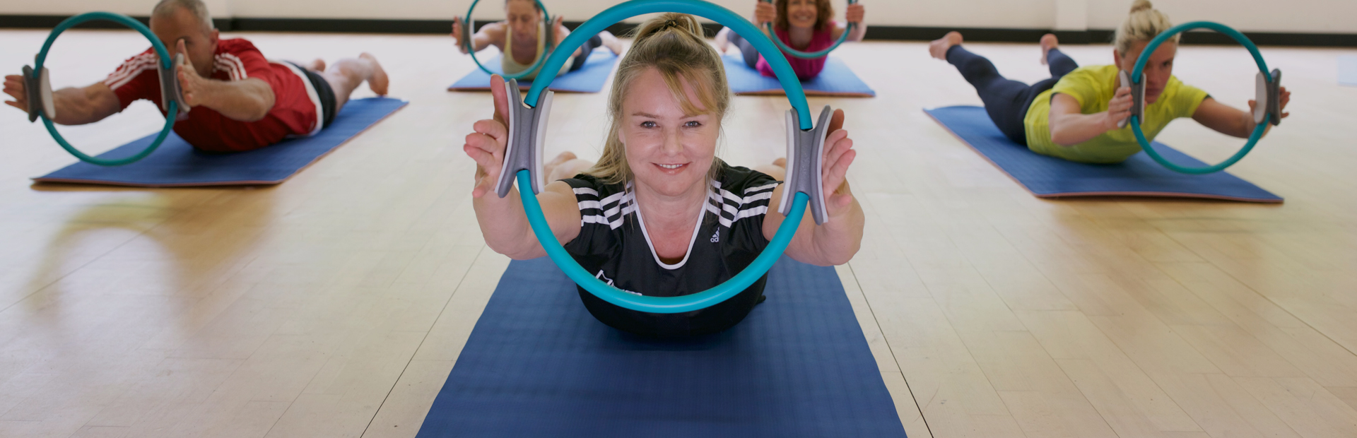 An HFE tutor delivering Pilates instructor courses with a Pilates circle