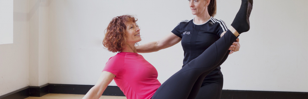 Experienced HFE Pilates instructor working with a client