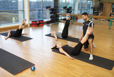 Pilates instructor leading a training course