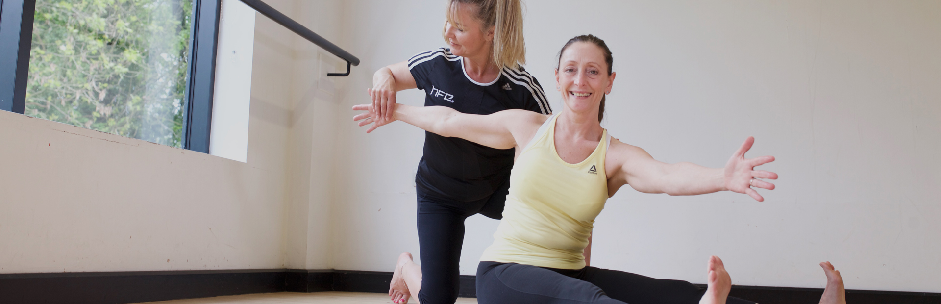 Pilates instructor working with an older adult