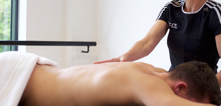 HFE massage tutor working with a client