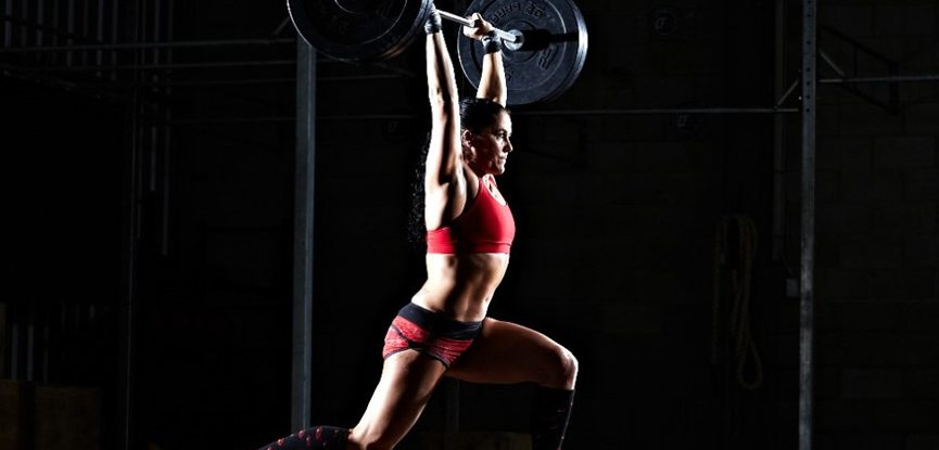 Women performing clean and jerk for the Grace CrossFit WOD