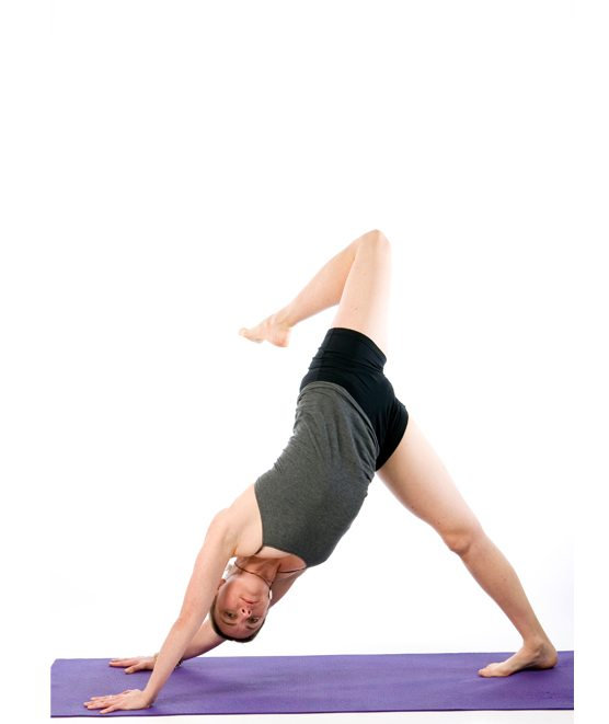 Sally Parkes performing a down dog variation yoga pose