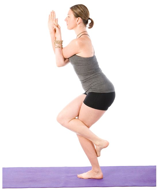 Sally Parkes performing the eagle yoga pose