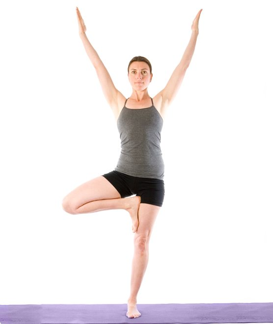 Sally Parkes performing a tree pose which aides healthy knees