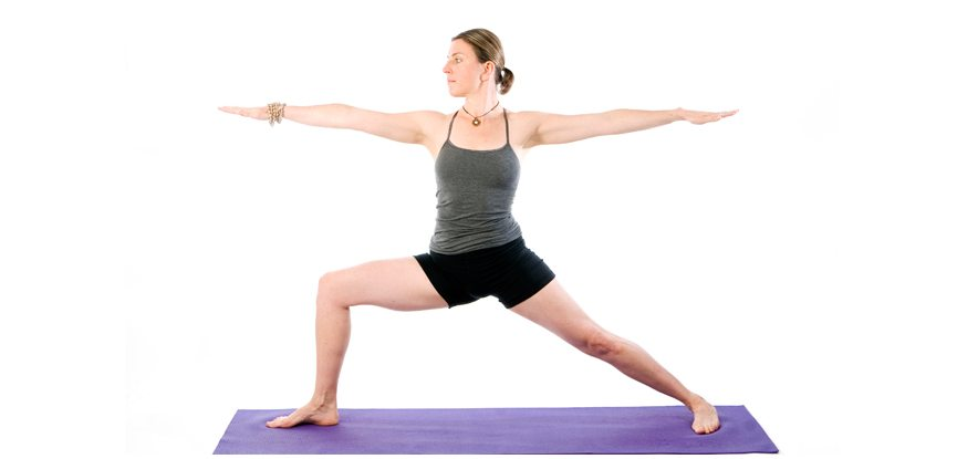 Sally Parkes performing the warrior 2 pose which is great for promoting healthy knees