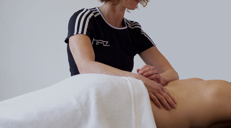 HFE's leading sports massage tutor working with a client on course