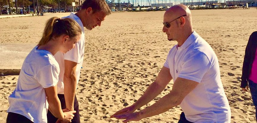 Personal trainer Iain Bainbridge training clients on a beach