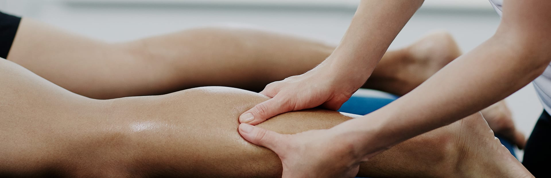 Sports massage therapist working on a client