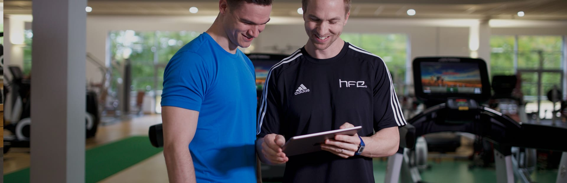 HFE tutor showing a student a digital version of a manual