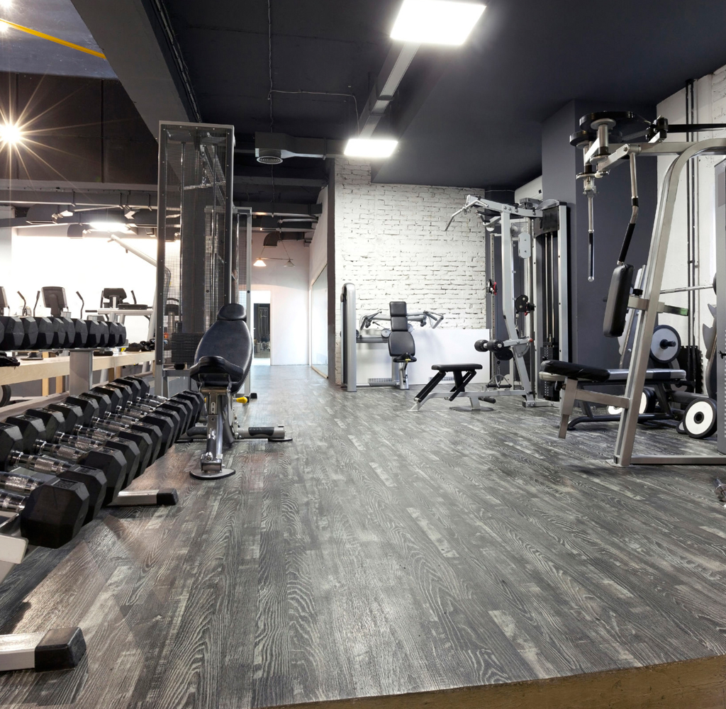 A fully equipped gym with resistance machines and weights
