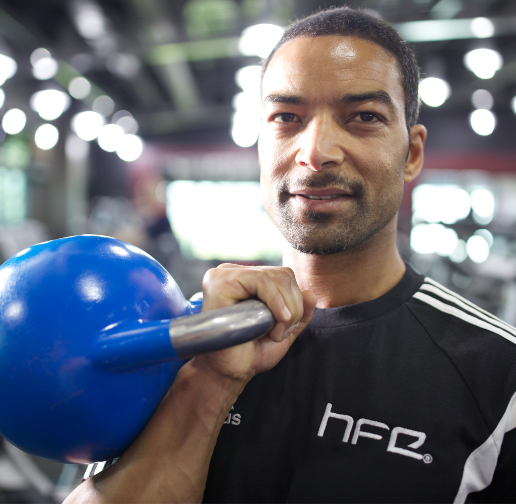 HFE personal training tutor holding a kettlebell