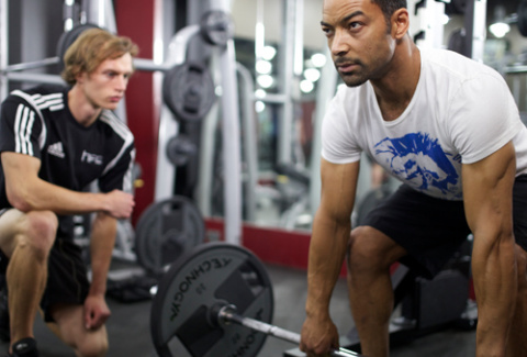 An HFE tutor working with a student on his personal trainer course