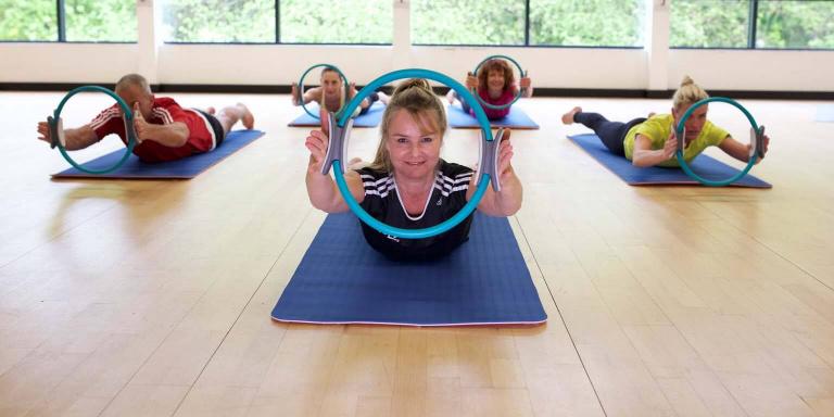 Pilates tutor with circle