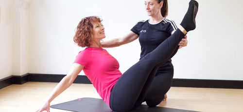 HFE Pilates instructor working with a client