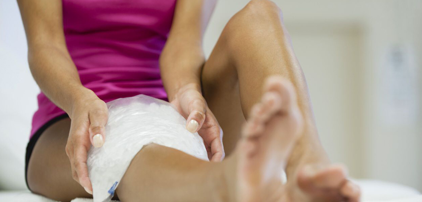 Applying ice to an injury to combat inflammation