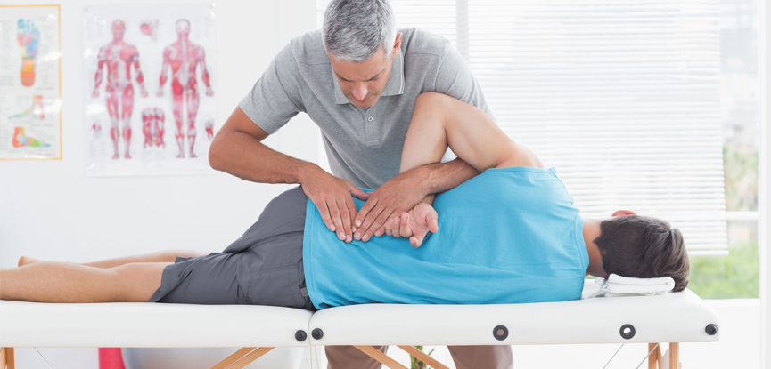 A qualified back pain professional studying a client's spine