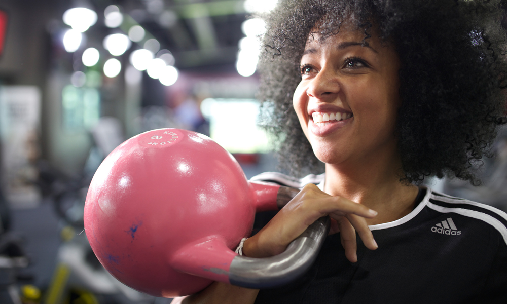 Female personal trainer holding a kettlebell