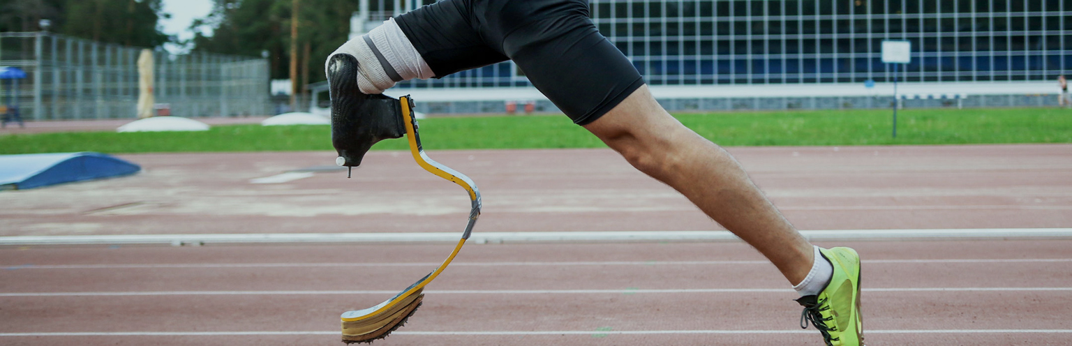 An athlete with an amputated leg on a running track
