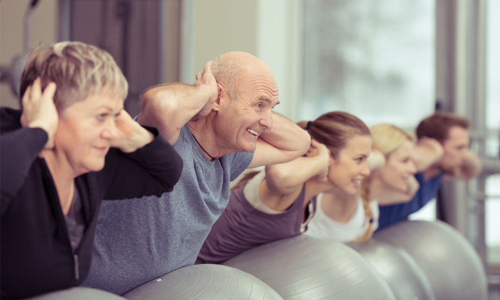 A group of older adults taking part in an exercise class