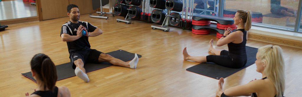 HFE Pilates instructor leading a class of students