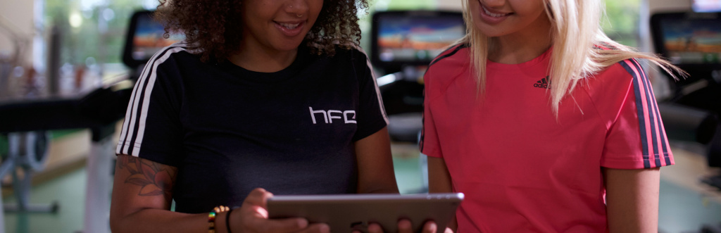 HFE personal training tutor using an iPad with a student