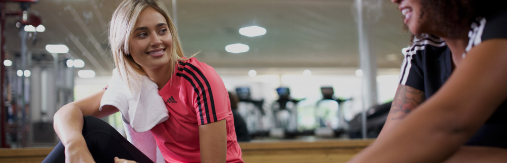 Girl in gym listening to tutor