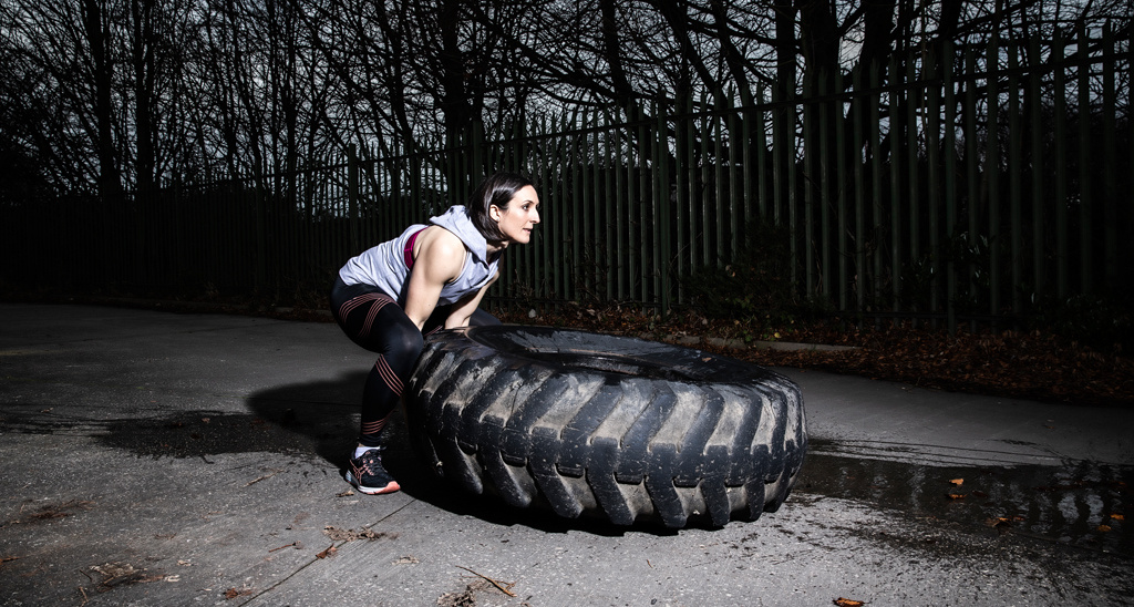 Personal training graduate Laura McNally flipping a tyre