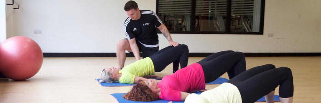 HFE Pilates tutor instructing a class