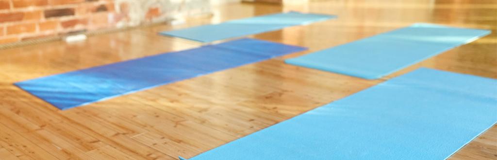 Pilates mats arranged in a boutique studio