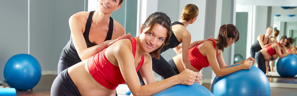 Pilates teacher working with a pregnant client