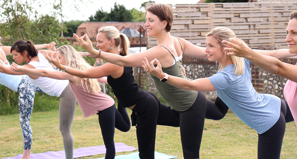 Sally Parkes teaching the lord of the dance pose at a yoga retreat