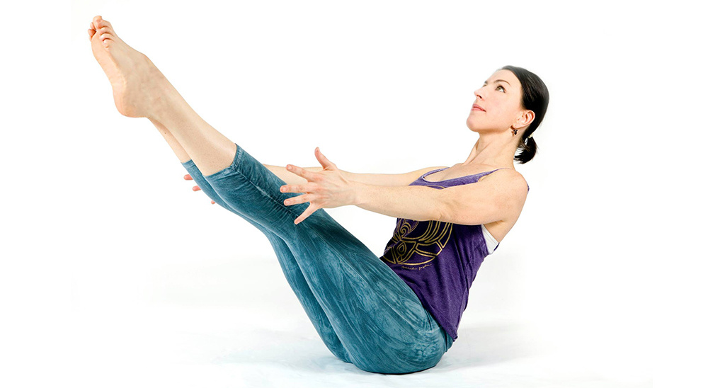Yoga teacher Sally Parkes performing boat pose