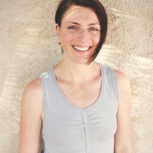 A headshot of international yoga teacher and bestselling author Sally Parkes