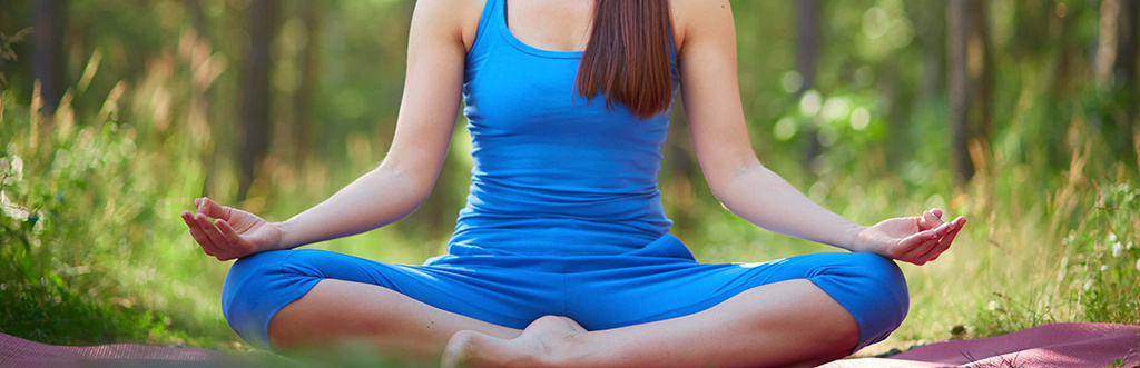 A woman sat in lotus pose