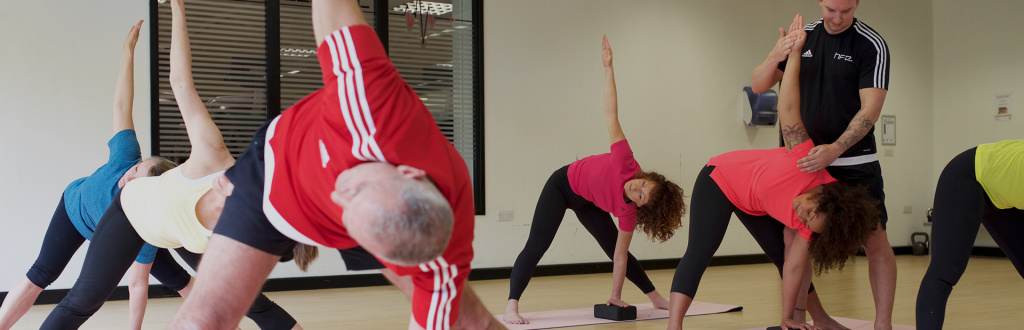HFE yoga instructor overseeing a yoga instructor course