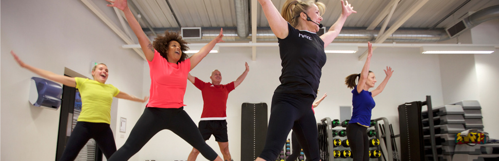 HFE studios leaping in the air on their exercise to music course