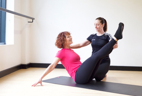 HFE instructor demonstrating advanced Pilates techniques