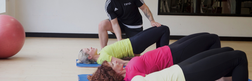 An HFE tutor leading Level 4 Mat Pilates instructor training