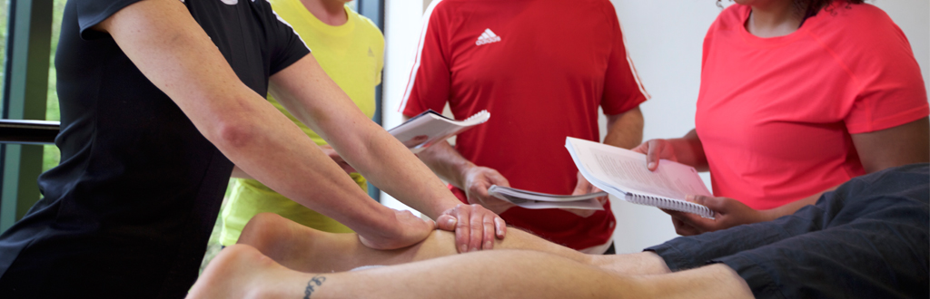 Students taking part in a sports massage course
