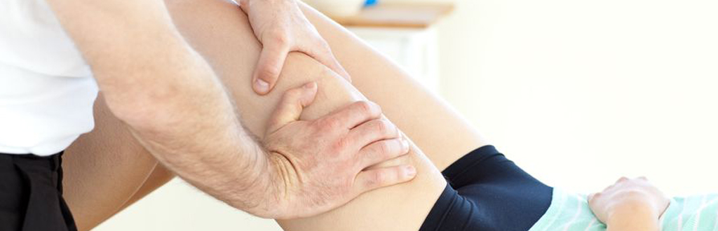 Self-employed sports massage therapist working in a private clinic