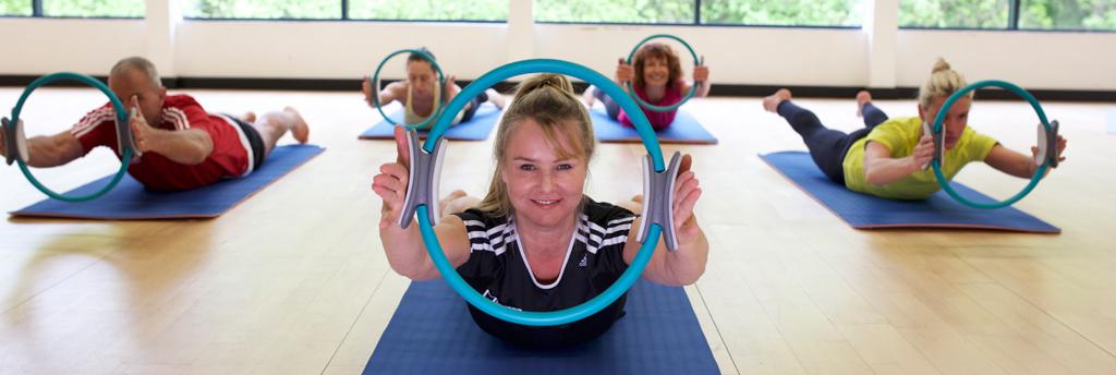 HFE tutor leading a mat Pilates class