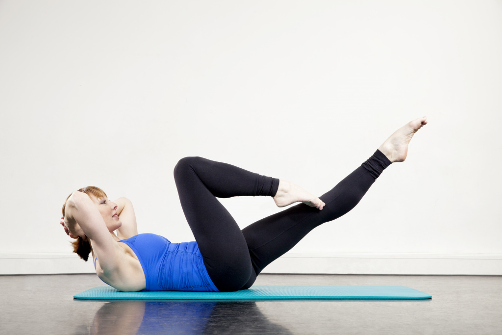 An image of Rachel Lawrence demonstrating a Pilates pose