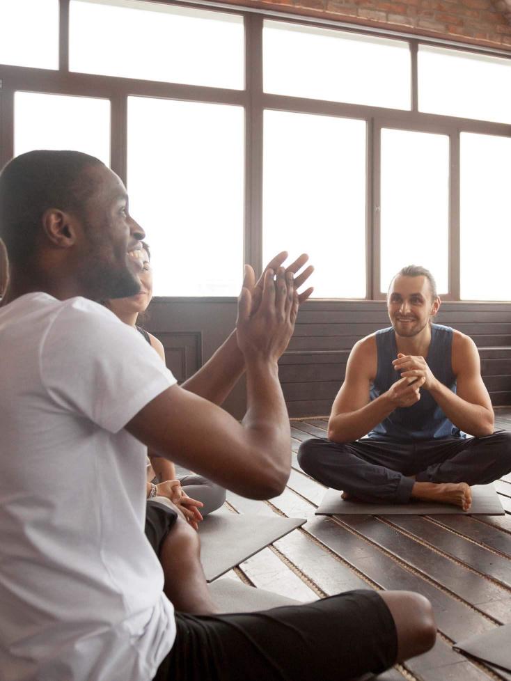 Pilates tutor sat in circle