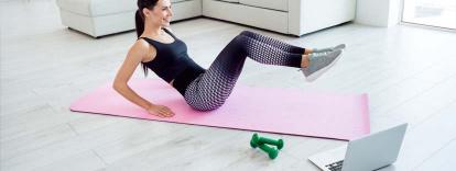 woman doing Pilates virtually