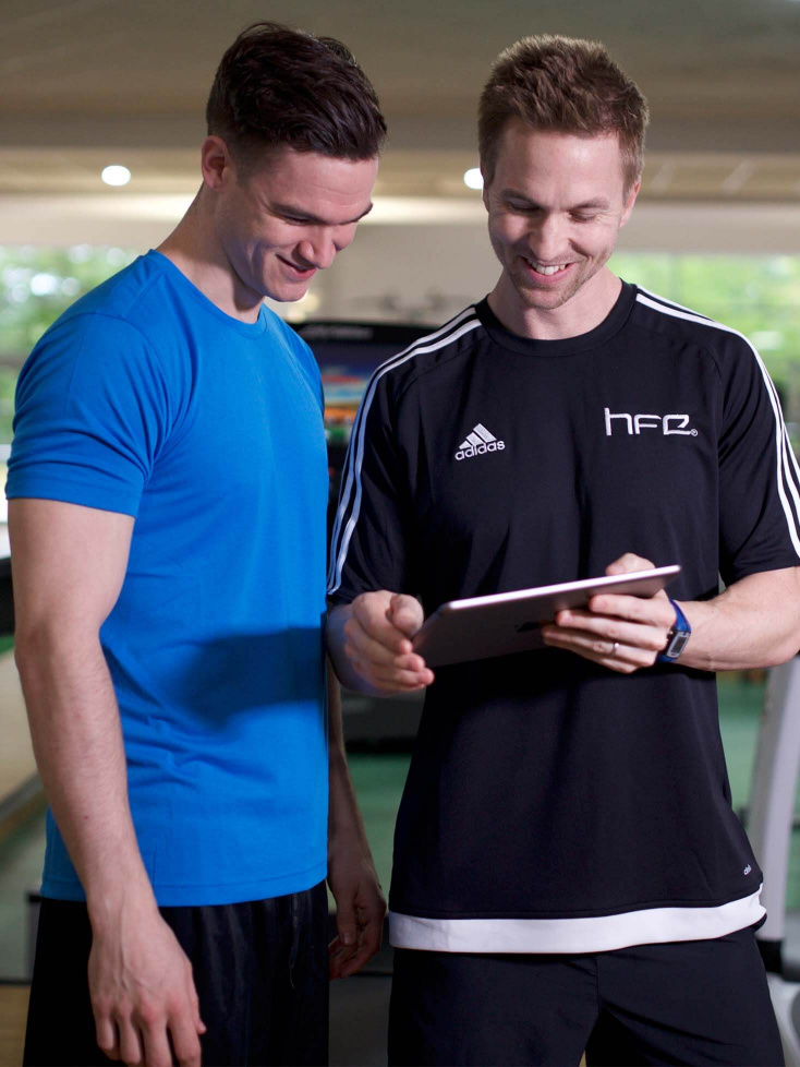 HFE tutor with ipad and student